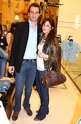 FRITZ VON WESTENHOLTZ and CAROLINE SIEBER at a party to celebrate the opening of the new H&M Flagship Store at 17-21 Brompton Road, London SW3 on 23rd March 2005.<br />