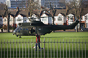 As a local dog-walker passes-by, we see a Royal Air Force Puma troop-carrying helicopter land briefly in Ruskin Park in the south London borough of Lambeth. It is believed that the RAF use various public spaces as part of emergency landing/evacuation location familiarisation in readiness of a future national emergency.  The Puma (registration XW216 from 230 Squadron, RAF Benson) is used as battlefield helicopters within the Joint Helicopter Command and provide tactical troop and load movement by day or by night.