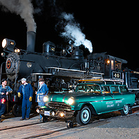 Night image of Hy-rail maintenence car #18 along side Engine #40 in Nevada Northern Rail Yard