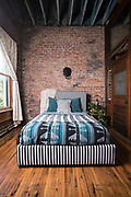 A bedroom in a loft. Photo by Brandon Alms Photography