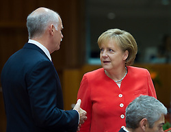 Angela Merkel, Germany's chancellor, right, speaks with George Papandreou, Greece's prime minister, during the European Summit meeting at EU Council headquarters in Brussels, Belgium, on Thursday, June 17, 2010. (Photo © Jock Fistick)