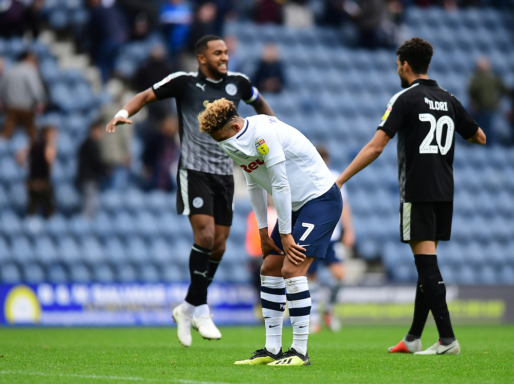 Preston North End's Callum Robinson at the end of the game as Reading's Liam Moore, left, celebrates the win with team-mate Tiago Ilori<br /> <br /> Photographer Chris Vaughan/CameraSport<br /> <br /> The EFL Sky Bet Championship - Preston North End v Reading - Saturday 15th September 2018 - Deepdale - Preston<br /> <br /> World Copyright © 2018 CameraSport. All rights reserved. 43 Linden Ave. Countesthorpe. Leicester. England. LE8 5PG - Tel: +44 (0) 116 277 4147 - admin@camerasport.com - www.camerasport.com