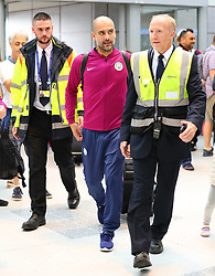 Pep Guardiola commits the ultimate sin of football team travel and forgets his passport. Pep got off the team bus and looked in his bag before getting back on the bus for 30 minutes while his passport was located and delivered in a chauffeur driven Mercedes as the Manchester City team arrive at Manchester Airport as they jet for Iceland