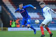 Harrison McGahey is challenged by Hawkins during the The FA Cup 2nd round match between Rochdale and Portsmouth at Spotland, Rochdale, England on 2 December 2018.