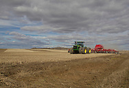 Photo Randy Vanderveen.Fairview, Alberta.11-05-05.Doug Cunningham begins his initial pass of seeding on a field between Fairview and Dunvegan Wednesday, May 4. Cunningham, who is planting peas, said a rain last week helped clear away snow and warm up the soil allowing him to finally get started with spring work.
