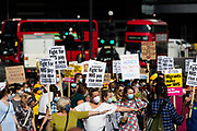 Nurses and care workers from St Thomas' Hospital, hold placards as they protest for a pay rise in London, Wednesday, July 29, 2020. Health care unions are launching a campaign for a pay rise for NHS (National health Service) nurses and care workers. NHS demonstration was also supported by the Black Lives Matter activists. (VXP Photo/ Vudi Xhymshiti)