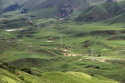 Power transmission line travels through a mountain landscape.  Sayaboury Province. Lao PDR