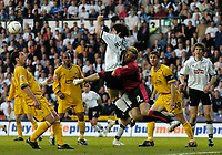 Fotball<br /> England 2004/2005<br /> Foto: SBI/Digitalsport<br /> NORWAY ONLY<br /> <br /> Derby County v Preston North End<br /> <br /> 19/05/2005.<br /> Coca-Cola Championship Play Offs, Second Leg. <br /> <br /> Preston's keeper Carlo Nash collides heavily with Derby's Paul Peschisolido as he comes out to make a save.