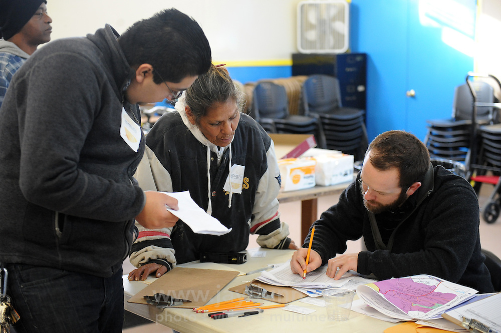 """John Connery of Applied Survey Research goes over count results from guide Diana Soto and volunteer Javier Celedon during Wednesday's """"2015 Homeless Point-in-Time Census and Survey."""""""
