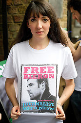 © London News Pictures. 05/10/2013.  London, UK. Nancy Thorburn, girlfriend of imprisoned Greenpeace journalist  Kieron Bryan holding a picture of her boyfriend on her t-shirt. Supporters of Greenpeace stage a demonstration outside the Russian Embassy in London to protest against the arrest of 30 Greenpeace activists, known as the 'Arctic 30' who charged with piracy by a Russian court, following a peaceful protest against Arctic oil drilling at an oil platform in the Pechora Sea. Photo credit Ben Cawthra/LNP