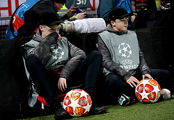 Ball boys wearing visors pitchside during the match