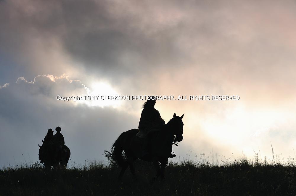 Silhoutte of horse riders on adventure holiday at Estancia Los Potreros