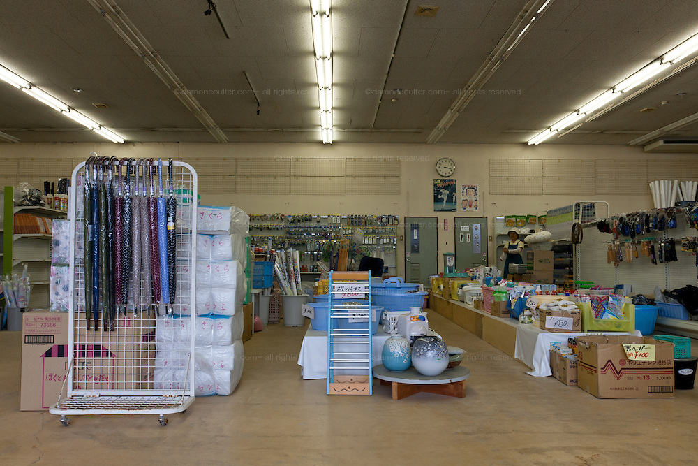 A store that was flooded by the tsunami piles stock to continue trading in Shinchi, Fukushima, Japan, Sunday July 3rd 2011