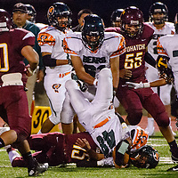 Wingate Bear Anfernee Delgarito (48) is brought down by Tohatchi Cougar Justin Leonard (15) Friday at Tohatchi High School.