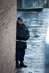© Licensed to London News Pictures . 29/12/2013 . Manchester , UK . A police officer stands behind police tape adjacent to the River Medlock off Oxford Road in Manchester City Centre . The search for 17 year old Adam Pickup from Stockport , who was last seen in the early hours of Saturday 28th December in Manchester City Centre following a night out with friends as , this evening (Sunday 29th December 2013), Greater Manchester Police say they have arrested two men in connection with the teenager's disappearance . Photo credit : Joel Goodman/LNP