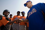 New York Mets General Manager Omar Minaya greets Ghanaian boys after an exhibition baseball game in the city of Tema, roughly 35 km east of Ghana's capital Accra on Saturday February 3, 2007. The game was being held on the occasion of the visit of a delegation from the American Major League Baseball Association made possible by the African Development Foundation, a non-profit organization that supports little league projects in selected African countries.
