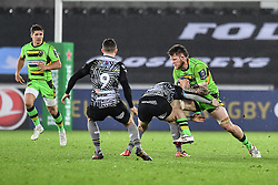 Northampton Saints' Teimana Harrison is tackled by Ospreys' Sam Davies<br /> <br /> Photographer Craig Thomas/Replay Images<br /> <br /> EPCR Champions Cup Round 4 - Ospreys v Northampton Saints - Sunday 17th December 2017 - Parc y Scarlets - Llanelli<br /> <br /> World Copyright © 2017 Replay Images. All rights reserved. info@replayimages.co.uk - www.replayimages.co.uk