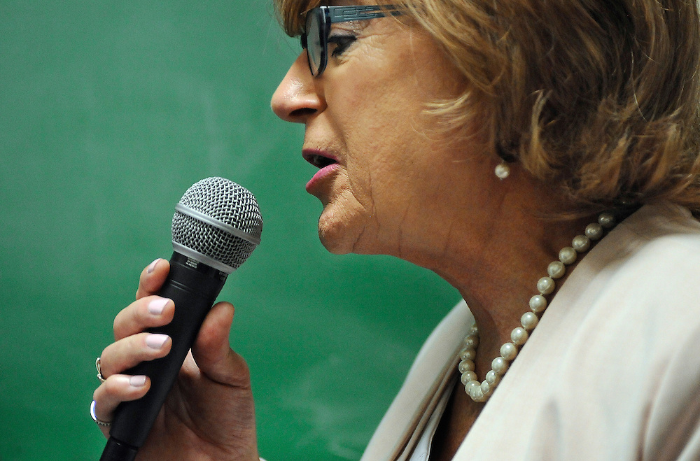 Brianne Roberts speaks into a microphone during a voice exercise at the University of Connecticut's Speech and Hearing Clinic in Storrs, Conn. Roberts is in a program at UConn that teaches transgender people how to sound more like the sex they identify with. (AP Photo/Jessica Hill)
