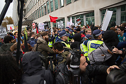 London, UK. 4 November, 2015. Metropolitan Police officers intervene among students attending a National Demonstration for a Free Education. The demonstration was organised by the National Campaign Against Fees and Cuts (NCAFC) in protest against tuition fees and the Government's plans to axe maintenance grants with effect from 2016.