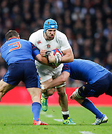 James Haskell of England (C) is tackled by Nicolas Mas of France (L) and Yoann Maestri of France (R) during the RBS 6 Nations match at Twickenham Stadium, Twickenham<br /> Picture by Andrew Tobin/Focus Images Ltd +44 7710 761829<br /> 21/03/2015