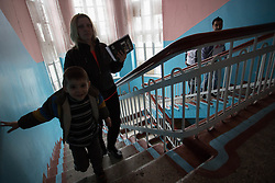 A mother brings her son to the MSF mobile clinic being held in the local health centre building in the town of Zorinsk, near Lugansk.