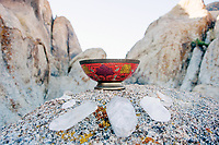 """Vintage Cloisonne Enamel bowl and organic crystal points altar in the boulders. Red symbolizes the Muladhara Chakra. Muladhara is a Sanskrit: word meaning """"root and basis of Existence."""" Mula means root and adhara means basis.The root chakra is one of the seven primary chakras according to Hindu tantrism. It is symbolized by a lotus with four petals and the color red. In this altar the Quartz crystals act as white lotus petals energizing the intention of the meditation. GRATITUDE"""