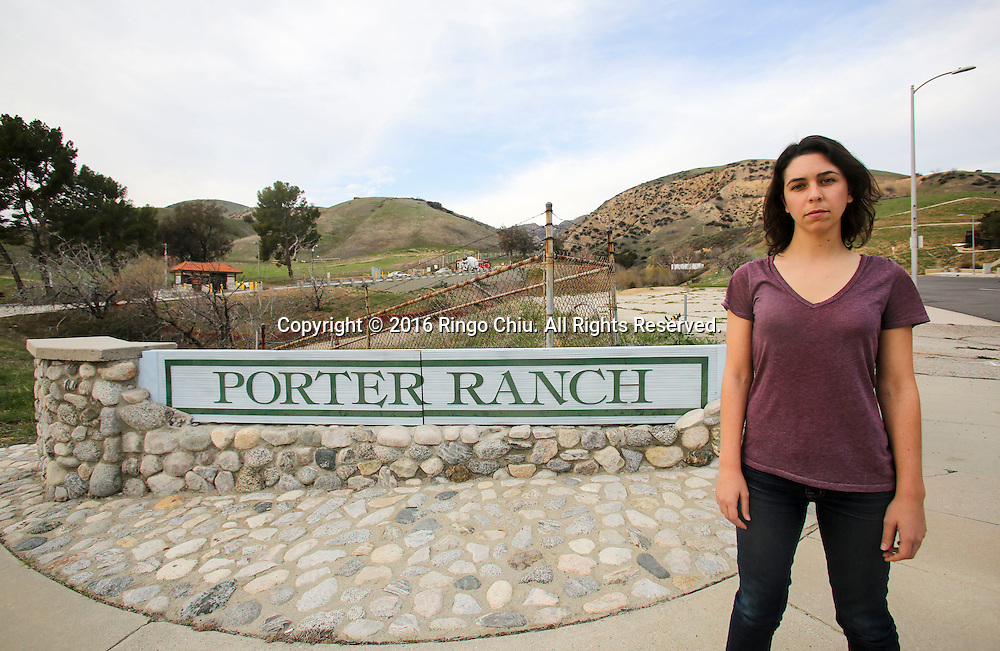 Alex Nagy, an activist from Food & Water Watch, who helps Porter Ranch residents to relocate and fight for their rights against gas company, stand at the entrance of the Southern California Gas Company, Aliso Canyon storage facility at the Porter Ranch area.<br /> (Photo by Ringo Chiu/PHOTOFORMULA.com)<br /> <br /> Usage Notes: This content is intended for editorial use only. For other uses, additional clearances may be required.