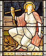 Stained glass window depicting Hope, designed by Henry Holiday 1880s, Campsea Ash church, Suffolk, England, UK