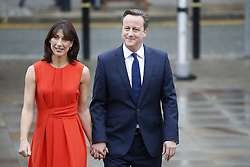 © Licensed to London News Pictures. 07/10/2015. Manchester, UK. Prime Minister DAVID CAMERON and SAMANTHA CAMERON arriving at Conservative Party Conference at Manchester Central convention centre on Wednesday, 7 October 2015. Photo credit: Tolga Akmen/LNP