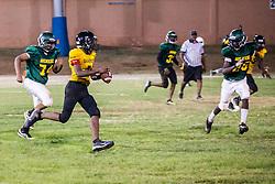 Raekoi Evans runs the ball.  Avengerz vs. Sharks .  Lionel Roberts Stadium.  St. Thomas, VI.  15 August 2015.  © Aisha-Zakiya Boyd