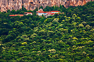 Orthodox monastery located in a lush forest