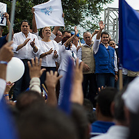 Juan Olando Hernandez, widely known as JOH, stands briefly with his correligionaries during a demonstration in Tegucigalpa
