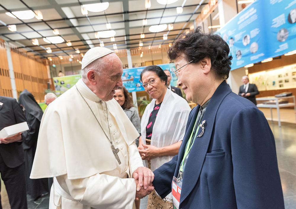 """21 June 2018, Geneva, Switzerland: At the end of an Ecumenical Encounter between Pope Francis and the World Council of Churches, Pope Francis is greeted by Rev. Prof. Dr Sang Chang, Presbyterian Church in the Republic of Korea. On 21 June 2018, the World Council of Churches receives a visit from Pope Francis of the Roman Catholic Church. Held under the theme of """"Ecumenical Pilgrimage - Walking, Praying and Working Together"""", the landmark visit is a centrepiece of the ecumenical commemoration of the WCC's 70th anniversary. The visit is only the third by a pope, and the first time that such an occasion was dedicated to visiting the WCC."""