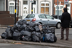 © Licensed to London News Pictures. 20/02/2019. Birmingham, UK. Birmingham bin men work to rule. Pictured, rubbish awaiting collection outside houses in Tarry Road, Alum Rock. Industrial action by Birmingham waste collection services is resulting in a build up of rubbish on the streets in areas of the City. Photo credit: Dave Warren/LNP