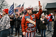 """06 DECEMBER 2020 - DES MOINES, IOWA: A man uses his smart phone to video record a rally in support of US President Donald Trump. About 1,000 supporters of outgoing US President Donald Trump rallied in Des Moines Sunday to show their support for the President and to protest the outcome of the US Presidential election. They started with a rally in the suburbs of Des Moines then drove in a motorcade through the city, ending at the State Capitol. They repeated many of Trump's discredited claims that the election was marked by fraud and that Trump actually won. The protest was a part of the national """"March for Trump"""" effort, culminating in a march in Washington DC on December 13. Joe Biden won the election, with 306 electoral votes to Trump's 232.       PHOTO BY JACK KURTZ"""
