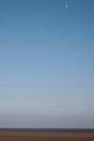 Moon rising over Sandymount Strand in Dublin Ireland