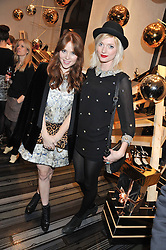 Left to right, ANGELA SCANLON and SOPHIE SUMNER at a party to celebrate the launch of a limited edition shoe The Chambord in celebration of Nicholas Kirkwood's partnership with Chambord black raspberry liqueur, held at the Nicholas Kirkwood Boutique, 5 Mount Street, London on 12th December 2012.