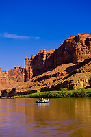 A Wilderness River Adventures motorized pontoon rafting down the Meander Canyon section of the Colorado River, going through the Loop, in Canyonlands National Park, Utah, USA.