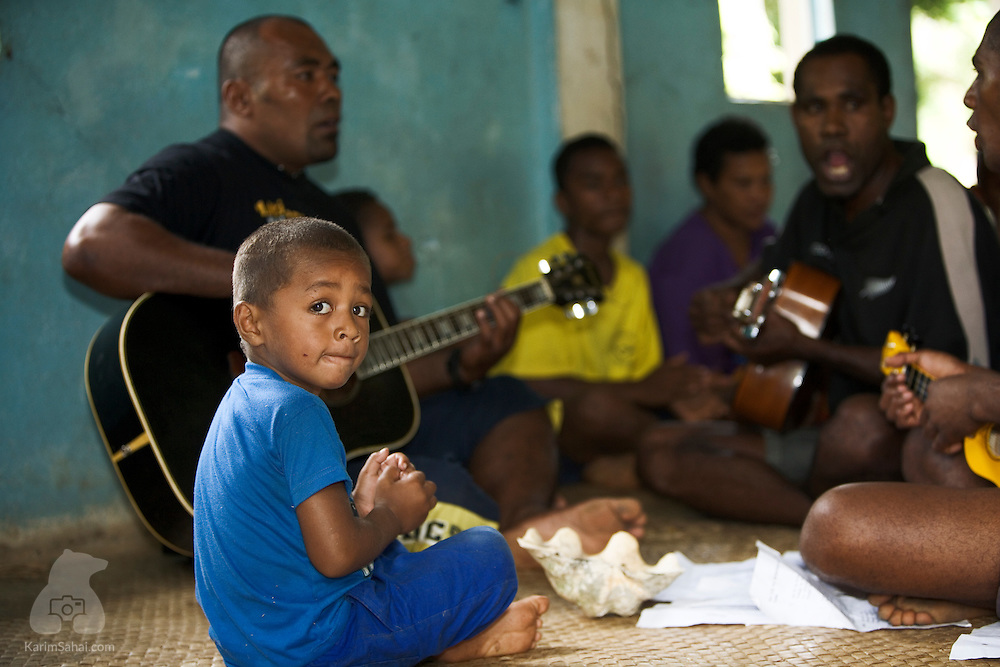 A boy and his relatives at the village's nakamal (communal house) in Nukubulavu, Kadavu island, Fiji.<br /> <br /> Kadavu is the fourth largest island in the fijian archipelago and is home to about 10,000 people.