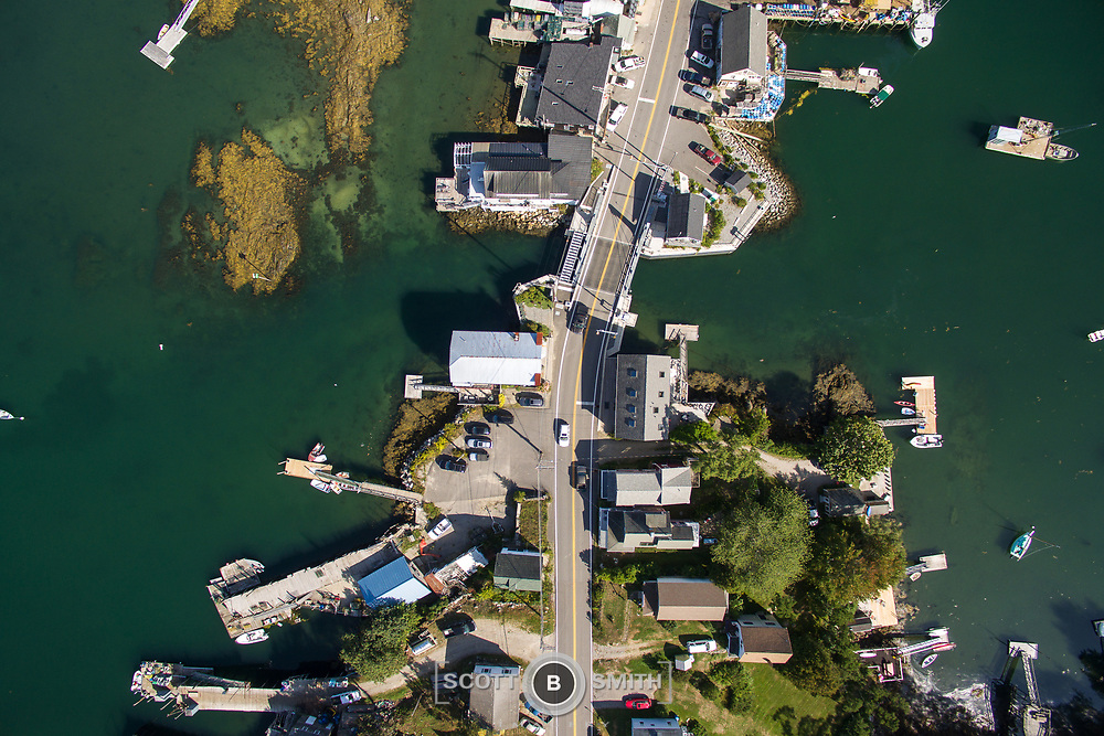 """Aerial views of Maine State Road 129 through the """"The Gut"""" to Rutherford Island. Area shown is part of South Bristol, with access to the mouth of the Damariscotta River. The Gut bridge is adjacent to East Boothbay, just to the west."""