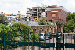 © Licensed to London News Pictures. 27/06/2014. London, UK. Demolition of the former News International site in Wapping, East London on 27th June 2014 next to the residential Quay 430 develpment. The 15 acre site was sold by News International (now News UK) for £150 million to St George of the Berkeley Group in 2012, who have renamed the site London Dock and have won planning permission to build up to 1800 new homes and a new secondary school. Photo credit : Vickie Flores/LNP