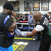 LAS VEGAS, NV - APRIL 14: WBC/WBA welterweight champion Floyd Mayweather Jr. (R) works out with co-trainer Nate Jones at the Mayweather Boxing Club on April 14, 2015 in Las Vegas, Nevada. Mayweather will face WBO welterweight champion Manny Pacquiao in a unification bout on May 2, 2015 in Las Vegas.  (Photo by Alex Menendez/Getty Images) *** Local Caption *** Floyd Mayweather Jr., Nate Jones