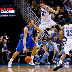 November 17, 2010; New Orleans, LA, USA; Dallas Mavericks power forward Dirk Nowitzki (41) of Germany drives past New Orleans Hornets power forward Jason Smith (14) during a game at the New Orleans Arena. The Hornets defeated the Mavericks 99-97. Mandatory Credit: Derick E. Hingle