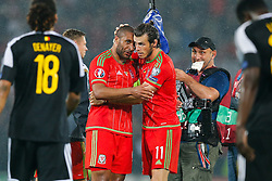Goalscorer Gareth Bale of Wales (Real Madrid)  hugs Ashley Williams (Capt) (Swansea City) after Wales win the match 1-0 to top their UEFA2016 Qualifying Group - Photo mandatory by-line: Rogan Thomson/JMP - 07966 386802 - 12/06/2015 - SPORT - FOOTBALL - Cardiff, Wales - Cardiff City Stadium - Wales v Belgium - EURO 2016 Qualifier.