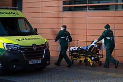 © Licensed to London News Pictures. 21/10/2021. London, UK. A patient arrives on the stretcher to The Royal London Hospital in east London. Health Secretary Sajid Javid warned Covid 19 cases could reach 100,000 a day this winter and urged people to take precautions against the virus. Photo credit: Marcin Nowak/LNP