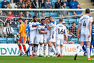 Rochdale  forward Ian Henderson (40) (4th from left) scores a goal (0-1) and celebrates with team mates during the EFL Sky Bet League 1 match between Gillingham and Rochdale at the MEMS Priestfield Stadium, Gillingham, England on 30 March 2019.