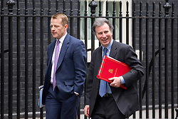 © Licensed to London News Pictures. 07/01/2013. London, UK. David Jones, the Welsh Secretary (L) and Oliver Letwin, the Minister of State at the Cabinet Office (R) are seen on Downing Street in London today (07/01/13) before the first cabinet meeting of 2013. Photo credit: Matt Cetti-Roberts/LNP