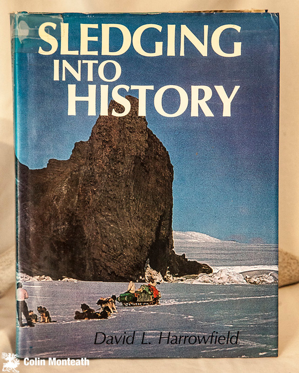 SLEDGING INTO HISTORY,  signed by author David Harrowfield, 1st edn., MacMillan, Auckland, 1981, 120 page large format hardback, VG in good jacket with minor tape repair top spine, colour plates throughout, an excellent survey of each of the historic huts on Ross Island and restoration work carried out in 1960s & 70s, plans for each hut, a good look at NZARP equipment, dog sledging etc. $NZ60 (Arnold Heine collection)