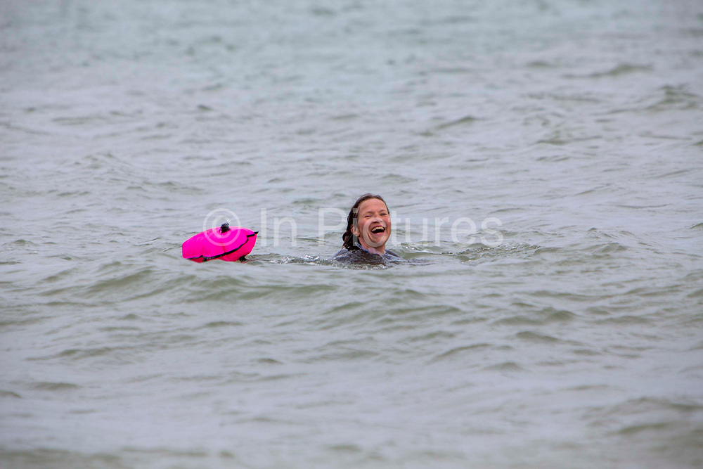 Award winning actress and Folkestone resident Jessica Hynes took part in a 4 mile sea swim with 12 laps of Folkestone sunny sands bay to raise money for charity on the 7th of July 2020 in Folkestone, United Kingdom. She swam for two different charities, one being the Folkestone community hub, which has been supporting vulnerable people during the Covid-19 lockdown and the second called Green Kordofan which supports children in a refugee camp in Yida, South Sudan. Mrs Hynes is one of many volunteers who have worked at the hub, which provides help by delivering groceries, collecting prescriptions or just being a voice on the end of the phone.The second charity is Green Kordofan, which supports children in a refugee camp in Yida, South Sudan and was founded by Raga Gibreel, also from Folkestone.The registered charity is currently raising money for essential hygiene facilities such as washing and toilet blocks, to make the camp safe for the children who have been displaced by war.