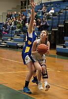 Franklin's Lauren Marsh blocks Gilford's Emily Smith during NHIAA Division III basketball Tuesday evening.  (Karen Bobotas/for the Laconia Daily Sun)